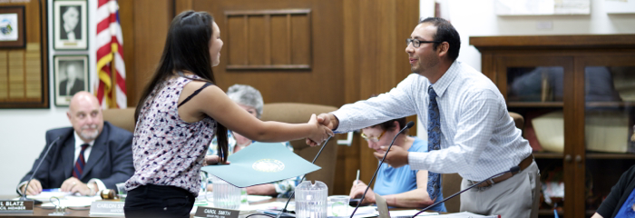 Ojai Valley School sophomore Savannah Moler is congratulated by Ojai City Councilman Severo Lara at a recent meeting -- Photo by Brendan Goldberg