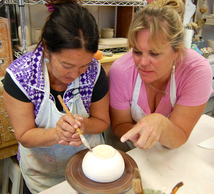 Cook Margaret Eddy collaborates with fifth grade teacher Michele Floyd on a project
