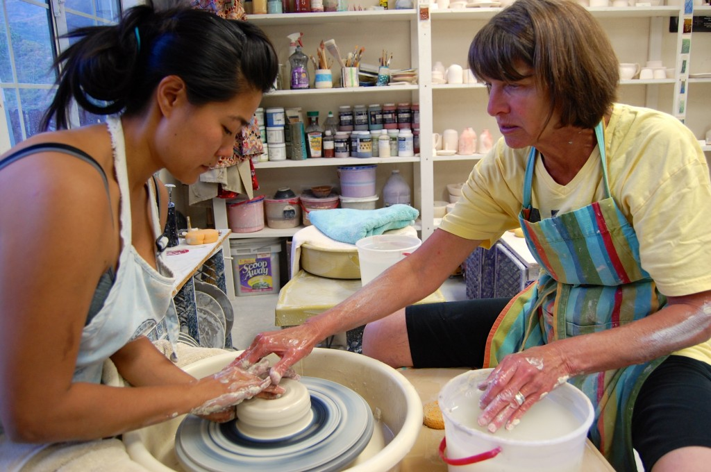 Ceramics teacher Jody Cooper helps barn manager Jen Konz create a piece of art during one of the Tuesday night ceramics sessions for OVS faculty and staff.