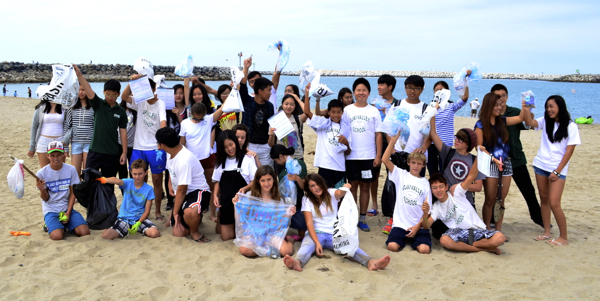 Students from the Upper and Lower campuses celebrate their day of making the beach a cleaner place to visit -- Photo by Nick Safko