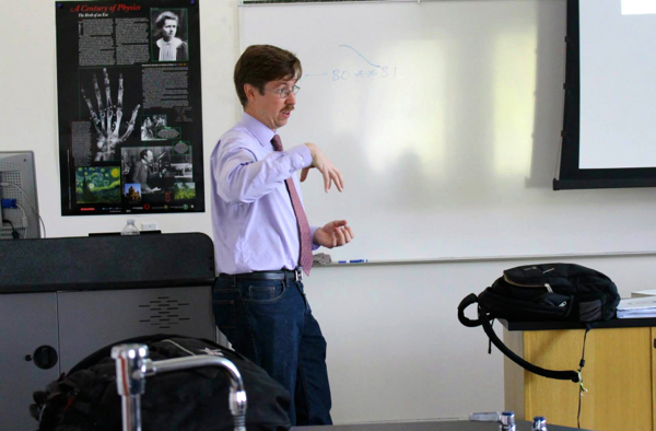 New Physics teacher Micah Sittig gets his point across in a recent class -- Photo by Lauren Rothman.