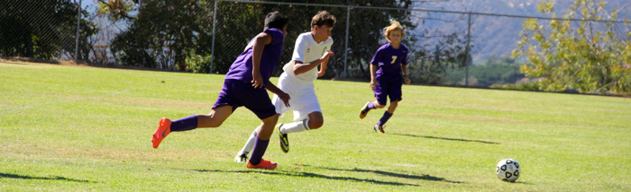 Senior Amir Podoswa moves the ball during last week's soccer game. Amir scored the first goal of his high school career -- Photo by Kai Lin