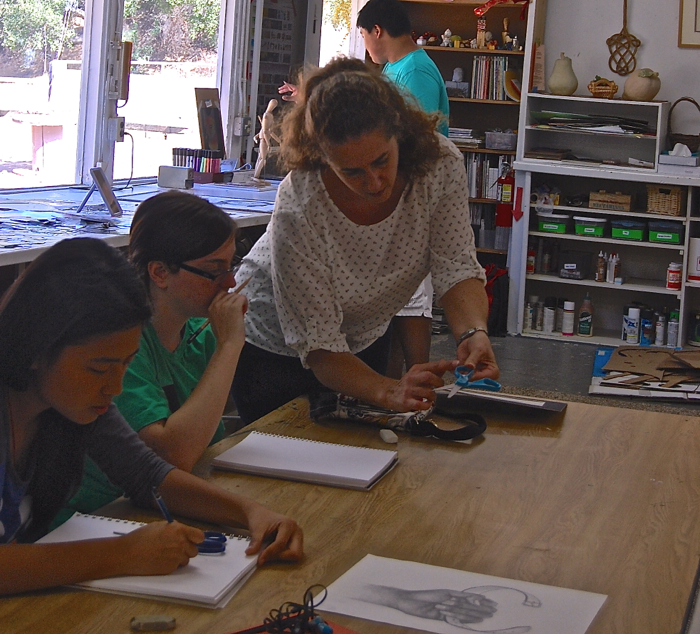 Art teacher Chia Hersk works with students on drawing techniques -- Photo by Natasha Freudmann