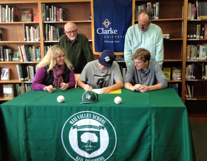 With his family and Upper Campus Head of School Carl Cooper present, Connor signs his letter of intent.