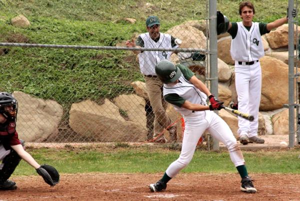 Lead off hitter Masaki Takamatsu swings away in Wednesday's season opener -- Photo by Kai Lin