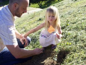 Director of Facilities and Grounds Mac Lojowski, with his daughter Isabella, take part in the planting -- Photo by Lauren Rothman