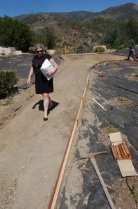 Mrs, Whipple enjoys the new, easy-to-walk-path to the girls' dorm.
