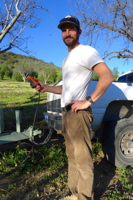 Arts Coordinator Ryan Lang off-loads manure from the equestrian barns at a local farm -- Photo by Daphne Psaledakis