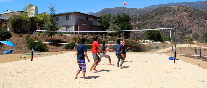 With the volleyball court completed, seniors test it out in the days before graduation -- Photo by Savannah Moler