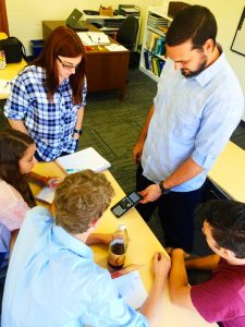 Ben Kolbeck demonstrates the uses of the calculator to his math students -- Photo by Kendall Shiffman