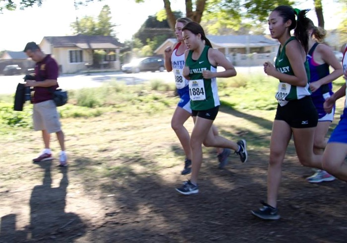 Freshman Tracy Zeng (left) and junior Winnie Chang gut it out on the course -- Photo by Momoe Takamatsu