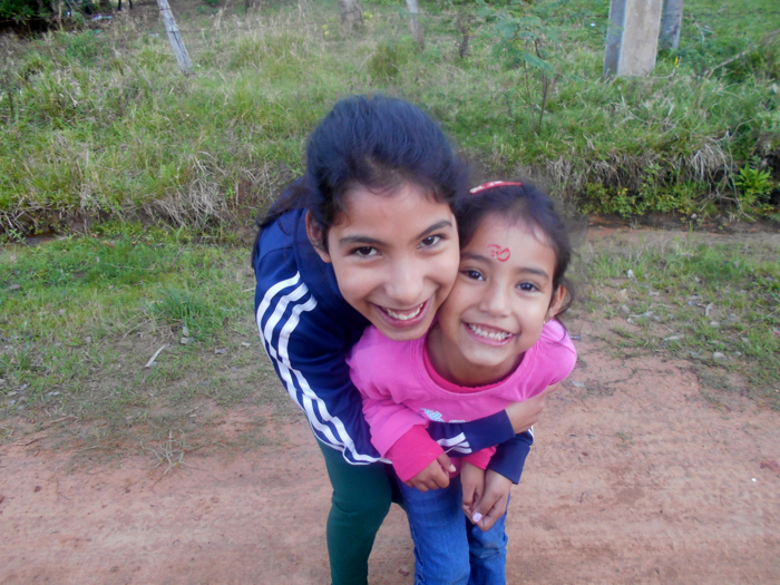 Leila (left) and Rocio pose for a photo on the walk to school -- Photo by Natasha Freudmann
