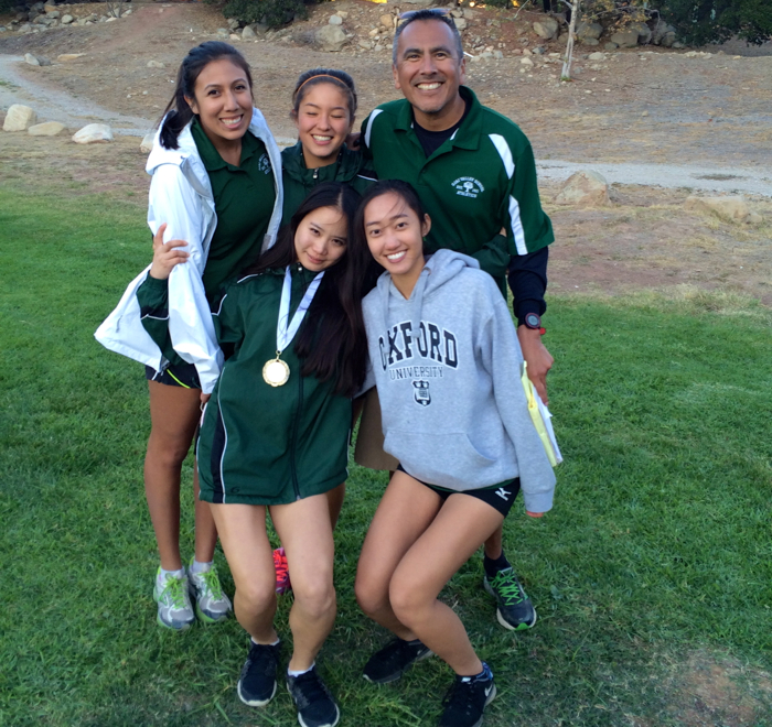 Coaches Apple Alvarez and Fred Alvarez with their Top Ten runners, Ally Feiss, Gilim Bae and Winnie Chang -- Photo by Tony Yang