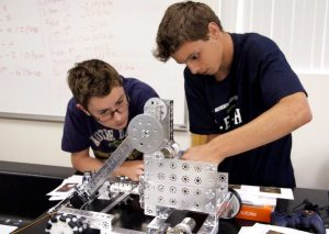Senior Joe Foulger and freshman Conway Gilbreth work together to construct their robot -- Photo by Misty Volaski