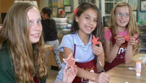 Students created star fish to adorn the virtual float created as part of this year's Rose Bowl parade celebration -- Photo by Patty Campbell