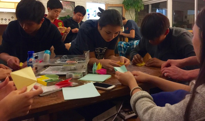 Students gathered for several evenings to fold paper cranes for Winnie -- Photo by Evelyn Brokering