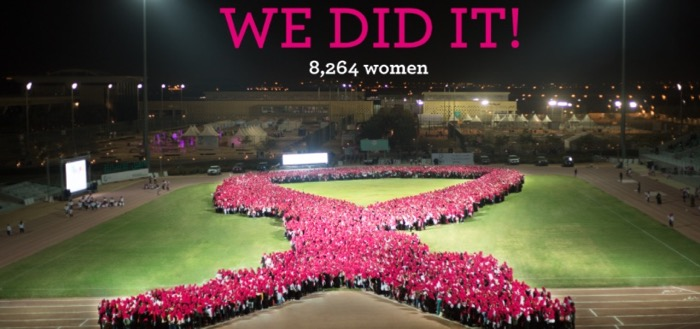 On a cold night in Saudi Arabia, a record 8,264 joined together in Saudi Arabia to form the largest ever human Breast Cancer Awareness ribbon. – Photo courtesy of 10KSA
