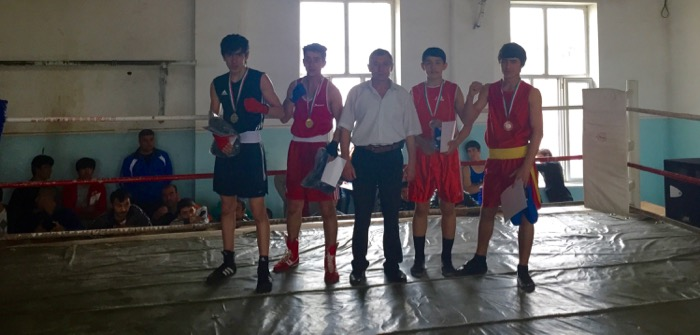 Usmon Mirzoaliev (far left) rose to the No. 3 fighter in his native Tajikistan.