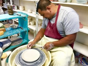 Upper Campus cook Moises Ferrel has become quite advanced in the craft of ceramics since taking lessons from Mrs. Cooper -- Photo by Fred Alvarez