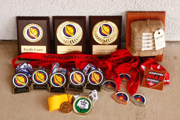 A sampling of the awards Miles has won since taking up archery four years ago -- Photo by Evelyn Brokering