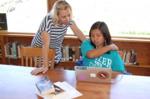 Mrs. Nishiya frequently works with students during library hours -- Photo by Clover Griffin