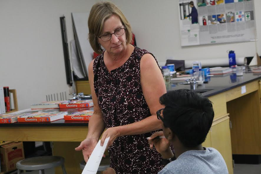 Mrs. Sackett with sophomore Soham Kondle -- Photo by Josh Han
