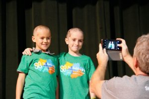 Jake and fellow-fourth grader Pako Rilling had their heads shaved to raise money for and awareness of Pediatric Cancer Research -- Photo by Misty Volaski