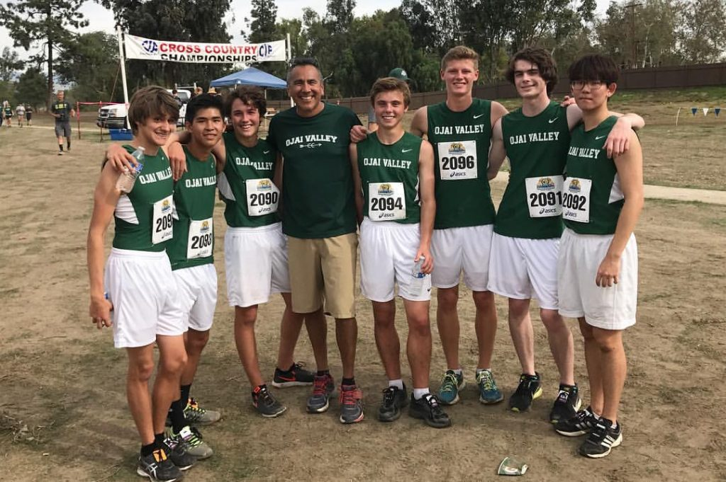 Cross country coach Fred Alvarez with the Magnificent Seven. From left to right, Jacob Tadlock, Erick Liang, Shea Colborn, Kase Skillern, Peter Weckerle, Sam Desmond and Won Jun Han -- Photo by Apple Alvarez
