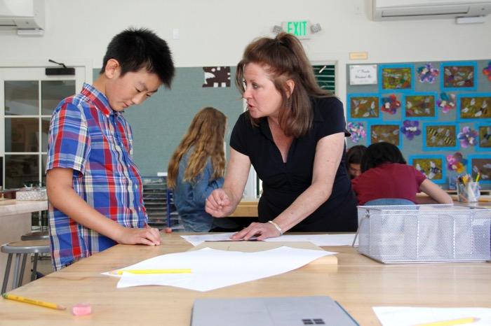 Art teacher Patty Campbell helped provide guidance with clock design -- Photo by Misty Volaski