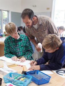 Woodshop teacher Ryan Lang added his expertise to the clock-making process -- Photo by Misty Volaski