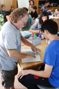 Guest artist Chuck Burright provided expert instruction on clock making to Lower students -- Photo by Misty Volaski