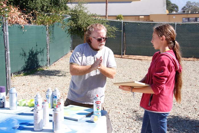 Mr. Burright provides guidance to eighth-grader Grace McHale during the clock-making process -- Photo by Misty Volaski