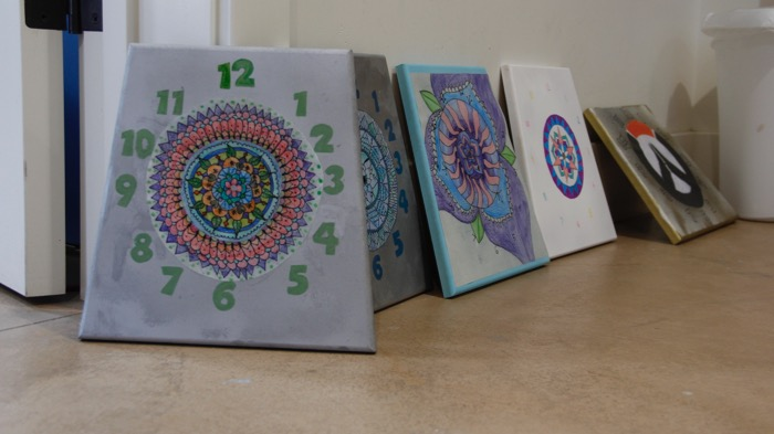 The students' clock creations sit ready to be displayed at the Lower Campus -- Photo by Misty Volaski
