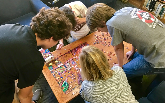 Members of the OVS Puzzle Club work with club advisor Ashlee Nishiya on the latest offering -- Photo by Fred Alvarez