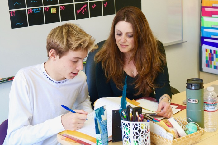 Learning Center teacher Kirste Macintyre works with freshman Nicky Pellegrini on school work – Photo by Josh Han
