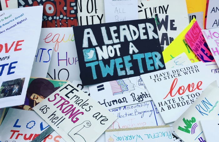 "The protest sign made by Violet Ruby, daughter of OVS parent Kirsten Stoltmann, sits with other protest placards at the end of the Women's March in Washington. It reads ""A Leader Not A Tweeter."" – Photo submitted by Kirsten Stoltmann"