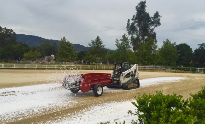Last school year, OVS replaced the fine sand in its equestrian riding arenas on both campuses with a new footing made from a mixture of quartz sand, polyester and synthetic materials. The move drastically reduced the need to water the arenas to keep down dust.